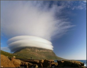 Lenticular clouds over Table Mountain, Capetown, South Africa.  The usual clouds are amazing enough...these are unbelievable.