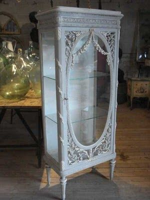 This beautiful gray rose swag cabinet is to die for...