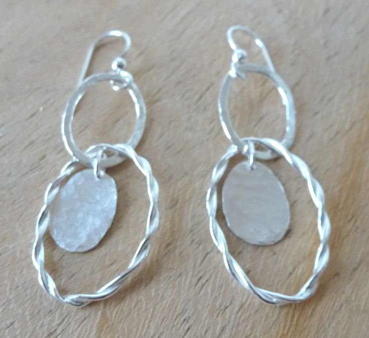oval earrings with battered and twisted wire hoops and battered discs