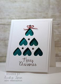 handmade Christmas card ... clean and simple ... negative space die cut tree of upside down hearts and stars backed in teal ... elegant look ... like the finishing touches of embossed borders and popped up panel ...
