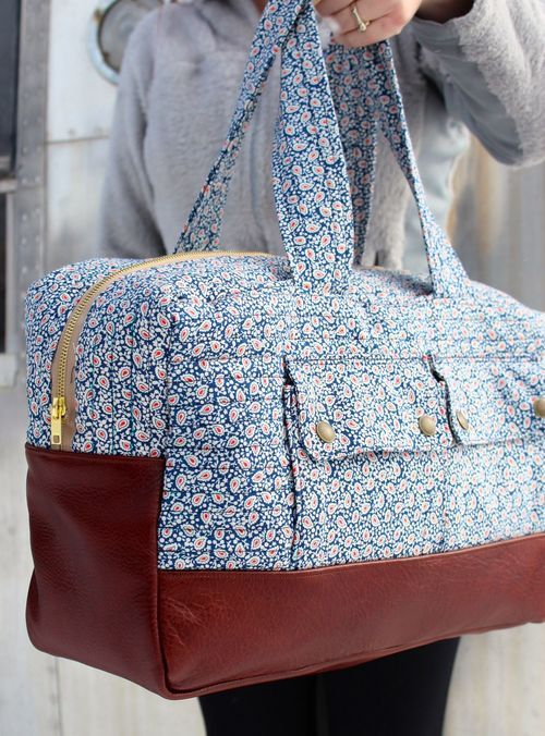 GREAT bag! Love the leather. Link to free pattern here: http://www.robertkaufman.com/quilting/quilts_patterns/Cargo_Duffle/