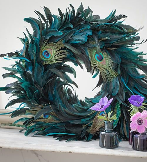 This peacock feather wreath is unusual and elegant, it can make a stunning centrepiece or wreath for the front door. Shop today.