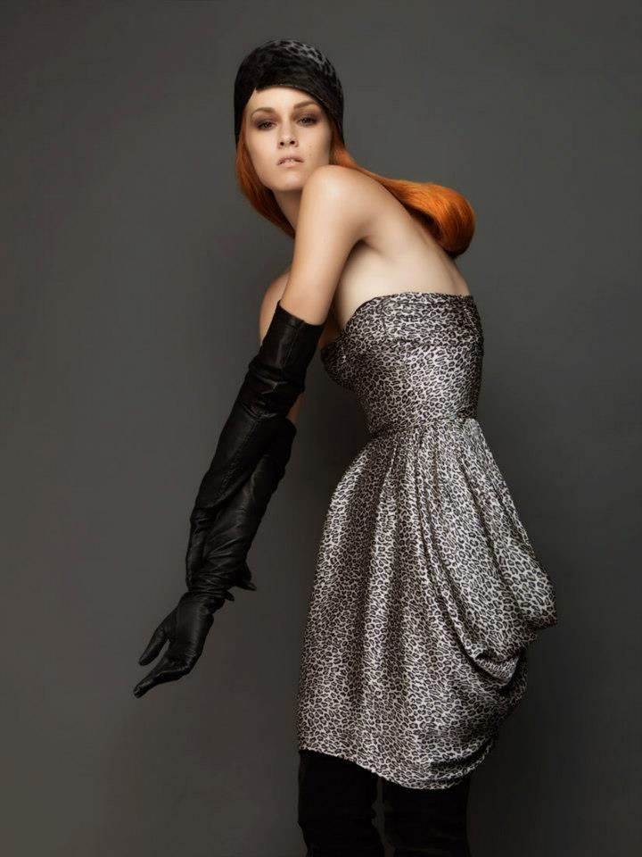 Animal print dress, over the elbow leather gloves and suede over the knee boots.