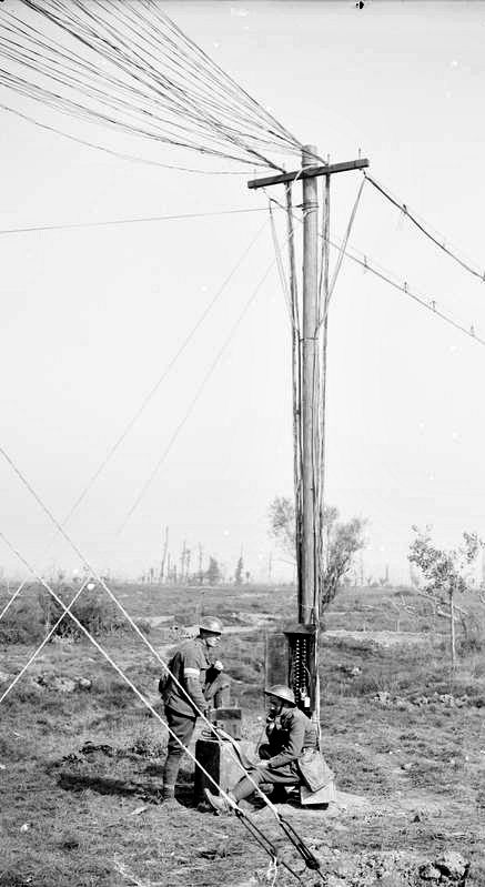 WWI, 1 Oct 1917; Officer and Private of the Royal Engineers testing telephone lines behind Zillebeke. Battle of Passchendaele. Cropped. © IWM (Q 6023)