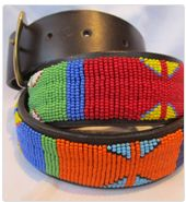 Kenyan FairTrade belts made in the Masai from leather and glass beads with brass buckles . Numerous styles and sizes