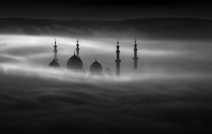 Sheikh Zayed Grand Mosque through a dense big wave fog, stands such as a Fairy tale stories of Sindbad snd Alaa Aldin