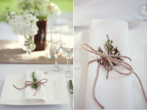 twine-tied herbs and wildflowers with cloth napkins ...