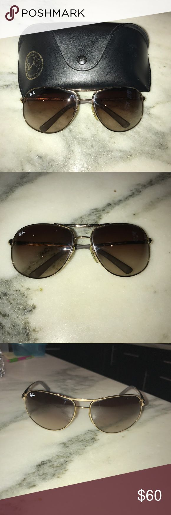 Ray Ban Aviators Authentic Ray Ban Aviators Style 3387. Gold frames with brown lenses. Very gently used, minimal to no signs of wear. Comes with original leather case, cleaning cloth, and papers. Own them today for such a great price! Ray-Ban Accessories Sunglasses