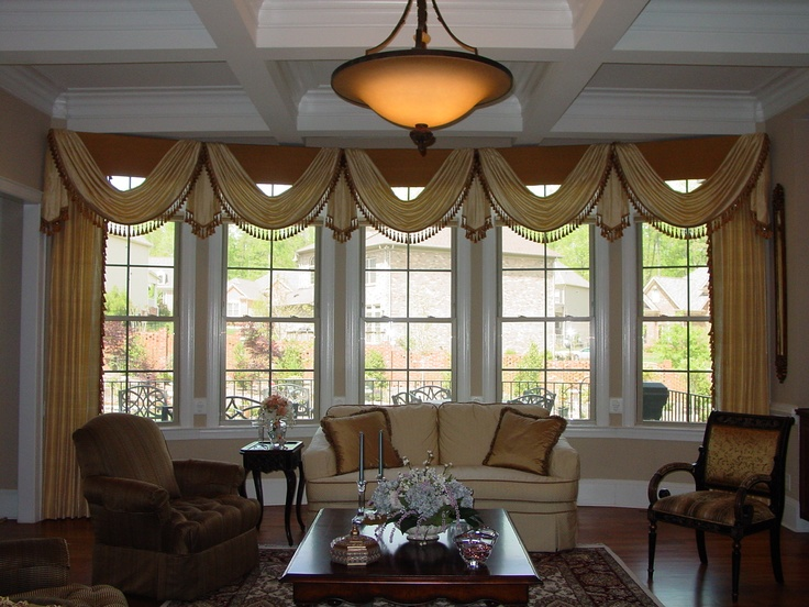 Swags over cornices with side panels. Custom Window Treatments
