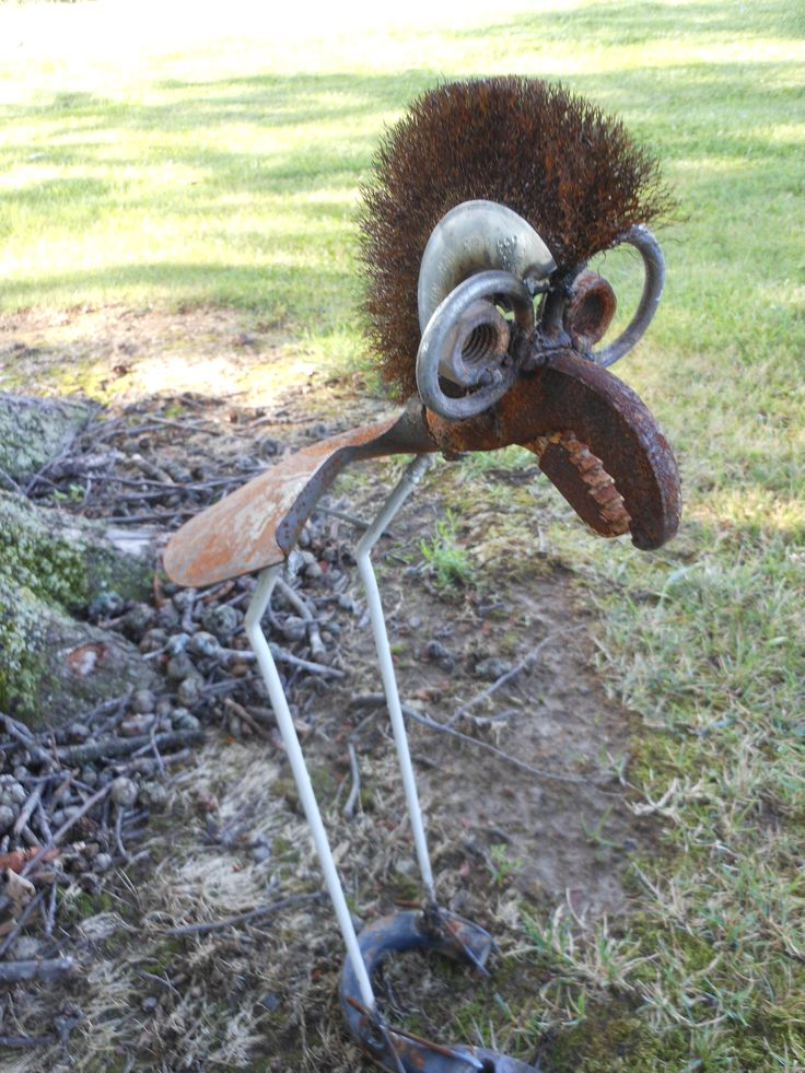 Fancy shovel bird with glasses rusty relics metal art my for Wire yard art