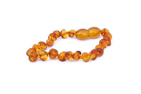 Childrens Amber Bracelet - Cognac Baroque by Amberocks. Amber teething bracelets are designed with the younger babies in mind. Each bead is individually knotted so if the bracelet was to break, only one bead would come free. The screw clasp is designed to break under stress. These can be worn against the skin around the wrist or ankle, and safely tuck away under clothing, perfect for when baby is asleep.
