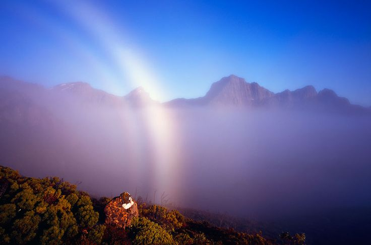 Australian weather calendar 2013 - August: The ethereal beauty of a mist bow and fog at Mount Anne in Tasmania