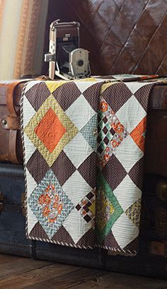 Designer Melissa Corry was inspired to make this quilt when she saw the pattern on her husband's dress socks. Retro-style fabrics give this easy quilt a modern vintage feel.