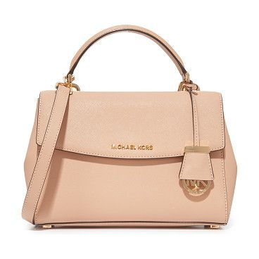 Ava satchel by MICHAEL Michael Kors. A structured MICHAEL Michael Kors cross body bag in saffiano leather. A logo charm accents the front, and snap gusset...