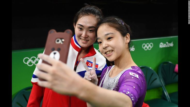 South Korean gymnast Lee Eun-ju takes a selfie with North Korean gymnast Hong Un-jong during Olympic training in Rio de Janeiro on Thursday, August 4.