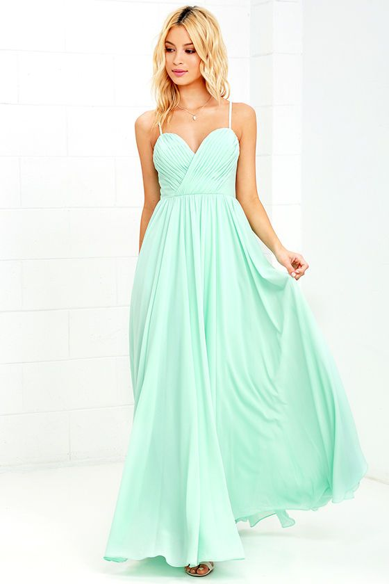 Putting on the Nod and Wink Mint Green Maxi Dress is the start to every great romance! Adjustable spaghetti straps support a gathered surplice bodice (with modesty stitch) while a full, woven maxi skirt sways below. Hidden back zipper with clasp.