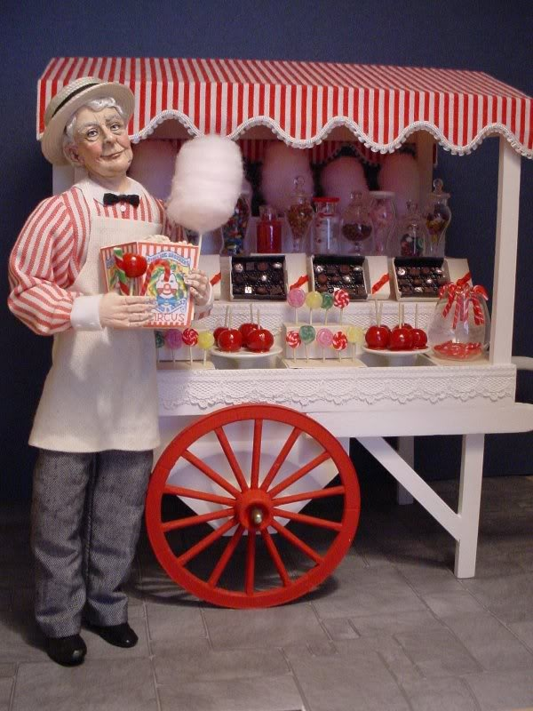 I remember Debra Dixon-Paver making this miniature doll and candy cart a few years back. I believe it was for a Marcia Backstrom competition.