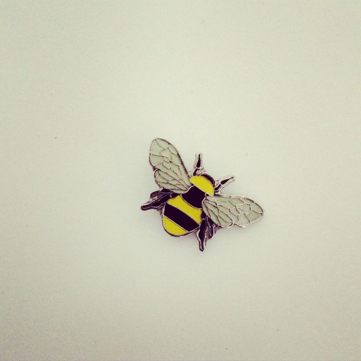 Tiny enamel bee badges by ManBeeCo - find them in the Etsy shop : https://www.etsy.com/shop/TheManchesterBee