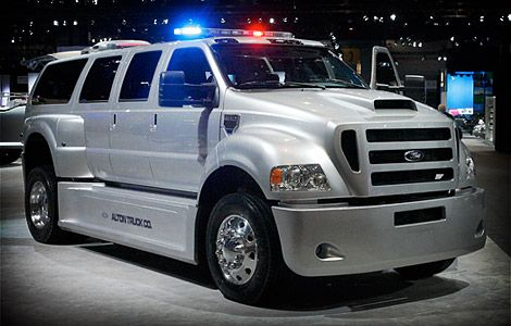 Ford F-650-based SUVs ($200,000) from Alton Truck Company. This 7-door beast features an insane amount of body work and packs in a Caterpillar 7.2L C7 ACERT engine with 230 hp and 660 lb.-ft. of torque. While the hoards of undead are smashed outside, you can enjoy hardwood floors, custom captain's chairs, wireless computer stations and a 42-inch plasma TV inside.