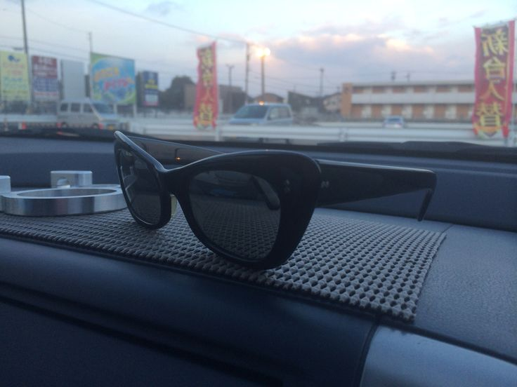 Early 60s black catseye Polaroid sunglasses with star shaped temple studs and 7 barrel hinges made in Australia.