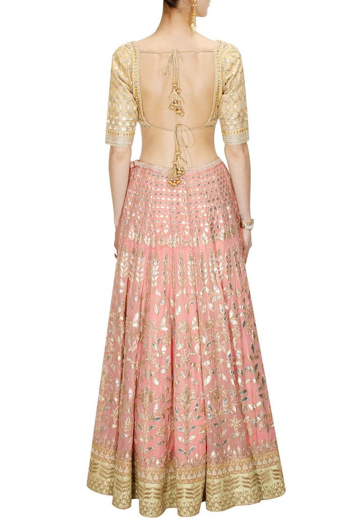 This Pinkish Peach color Bridal Lehenga Choli is featuring georgette fabric embellished with traditional gota patti embroidery in floral pattern. This Pinkish Peach color Bridal Lehenga Choli is paire