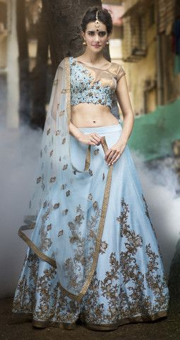 Featuring this hand crafted blue raw silk lehenga encrusted with beading, crystals,sequin and bugle beads with mesmerising motives. The attire finishes with antique edge and cancan underlayer adds mor