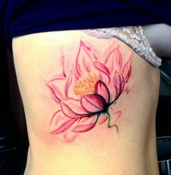Chronic Ink Tattoo - Toronto Tattoo  Watercolor style lotus tattoo on the ribs, done by Martin.