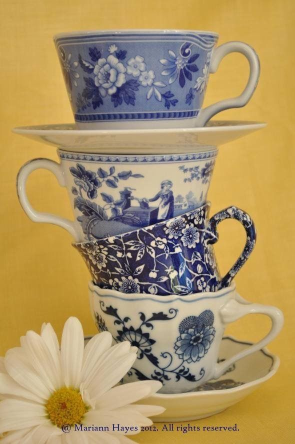 Stacked blue and white teacups