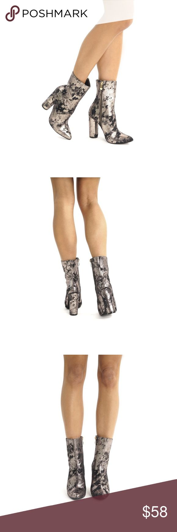 """METALLIC ANKLE BOOTIES The Silver Pewter Metallic Ankle Boots are your new ultimate style weapon! Chic, metallic & black spatter print covers a pointed toe upper that rises into a fitted shaft. All pictures showing actual product. Pictures taken exclusively for Style Link Miami. Price firm  Lightly cushioned insole Rubber sole  4.5"""" rounded heel 8.25"""" zipper at instep Runs true to size Model is wearing a size 7 Style Link Miami Shoes Ankle Boots & Booties"""