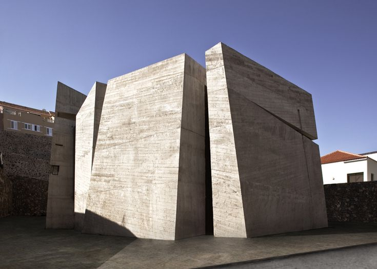 This church comprises four chunky concrete volumes separated from one another by sliced openings