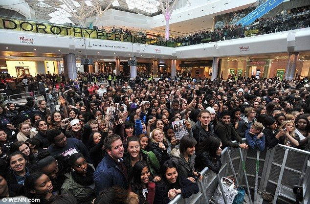PEOPLE WAITING FOR SOMETHING TO HAPPEN - Fans waiting for the Kardashian at Westfield Shopping Center in London