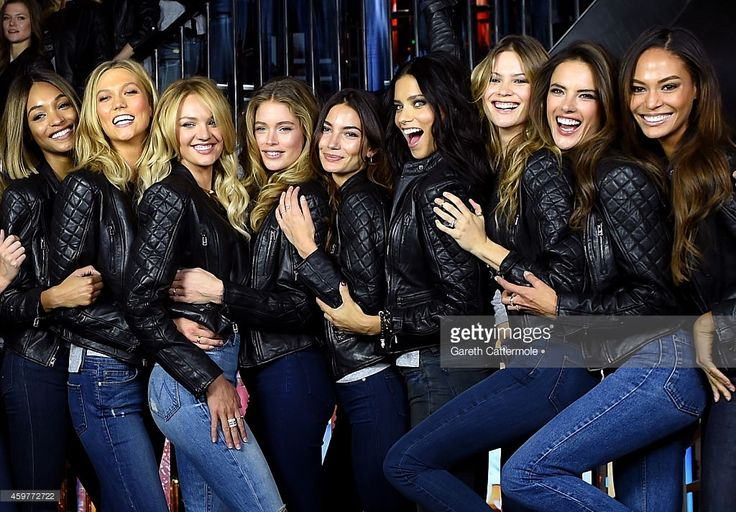Victoria's Secret Models Jourdan Dunn, Karlie Kloss, Candice Swanepoel, Doutzen Kroes, Lily Aldridge, Adriana Lima, Behati Prinsloo, Alessandra Ambrosio and Joan Smalls attend the 2014 Victoria's Secret Fashion Show - Bond Street Media Event on December 1, 2014 in London, United Kingdom.