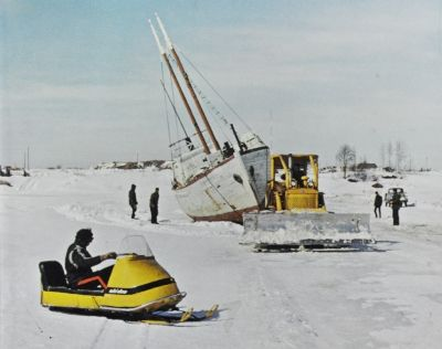 Sailboat during winter being hauled over the ice