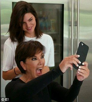 Selfie time: Kendall was at first reluctant to take selfies with Kris but then she got into it