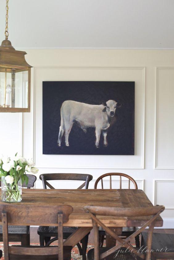 Farmhouse table & mix of dining chairs.  vintage pendant & Cow Portrait