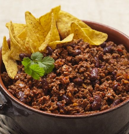 Quorn Meat Free Quick Chilli Con Carne. Cooked in just 15 minutes, try this chilli con carne, with Quorn Meat Free Mince, onion, and kidney beans topped with fresh coriander.