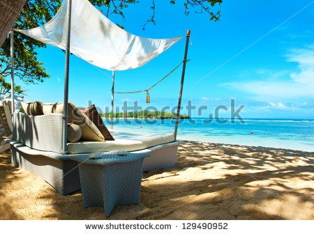 luxury relax chair on a beautiful tropical beach. sunny day - stock photo