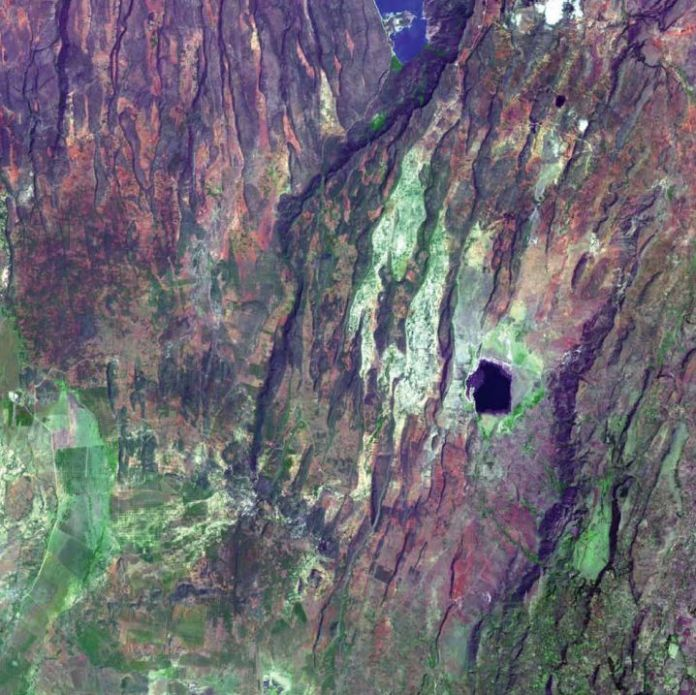 East African Rift, Kenya – The East African Rift is a classic example of rifting, an area where tectonic plates move apart from each other. Rifts often form  stunning geological features. The East African Rift is characterized by deep valleys in the rift zone, sheer escarpments along the  faulted walls of the rift zone, a chain of lakes within the rift, volcanic rocks that have flowed from faults along the sides of the rift, and  volcanic cones where magma flow was most intense. Photo: Boyd…