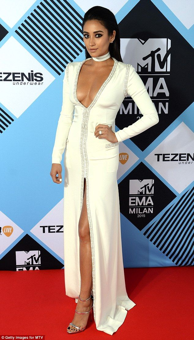 Slinky: Pretty Little Liar starShay Mitchell is stunning in a figure hugging white gown that's slashed to reveal her finest assets