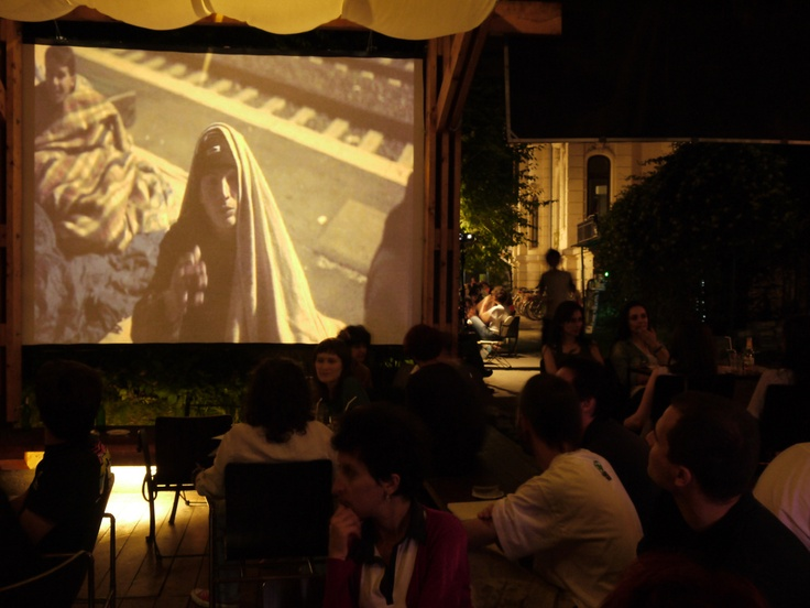"Screening of the UNHCR/Magnum project ""60 Years - 60 Lives"", produced for the occasion of the 60th anniversary of the UN Refugee Agency, during the SlideLuck PotShow event in Bucharest, being held as part of celebrations to mark World Refugee Day in Romania. © UNHCR/C. Liute/June 2011"
