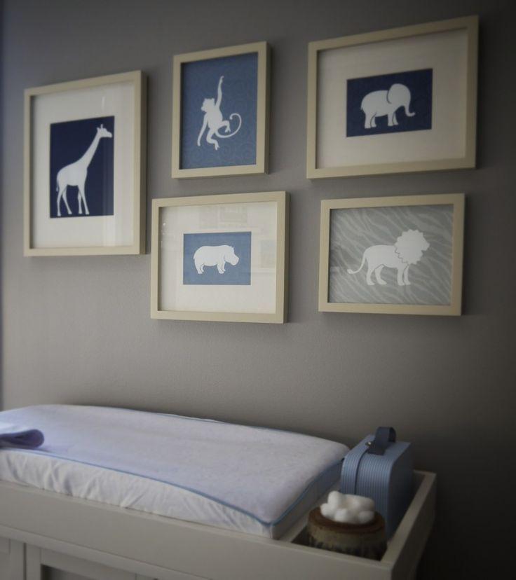 Cuadros decorativos con siluetas de animales.