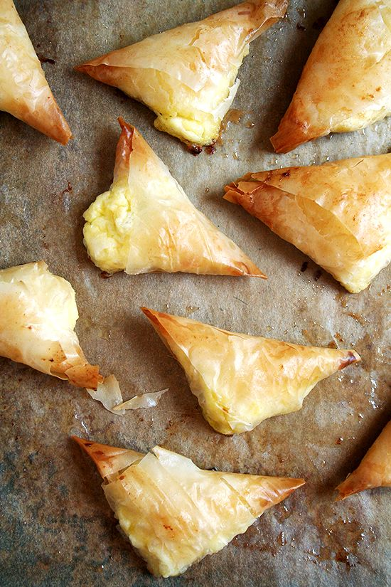 Tiropitas - cheese and egg filled fillo dough triangles. (Man... where was this recipe last night when I was fussing and experimenting with some philo dough!??)