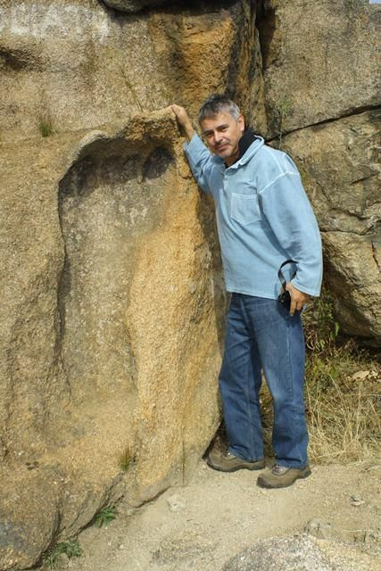 This is the infamous giant footprint found in South Africa. It is approximately 5' tall and it's embedded in granite! It's estimated to be 200 Million years old. Wow.
