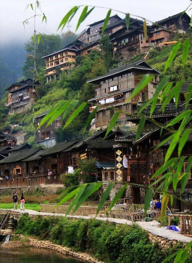 The ancient Miao village nestles under the hill, Guizhou province, China.