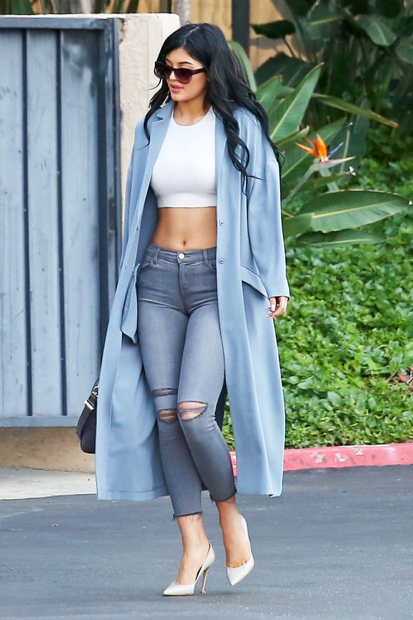 Kylie Jenner Has Officially Begun Dressing Exactly Like Kim #refinery29  http://www.refinery29.com/2014/12/79612/kylie-jenner-winter-crop-top-photos#slide1  Kylie Jenner was photographed going into Children's Hospital Los Angeles wearing cropped J Brand jeans and a powder blue ASOS duster, accessorized with Jimmy Choo stilettos and abs. Seriously: those abs.