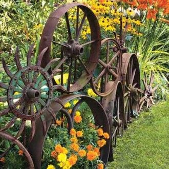 Rusty old wheels as border edging