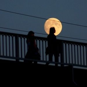 moon over silhouette of person in linz austria