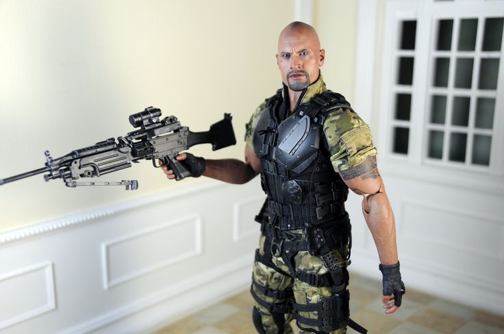 Dwayne Jonson as Roadblock, featuring a highly detailed head sculpt, finely tailored costume and an array of weapons. http://www.sideshowtoy.com/. Diorama by Regent Miniatures Ken Haseltine http://www.regentminiatures.com.
