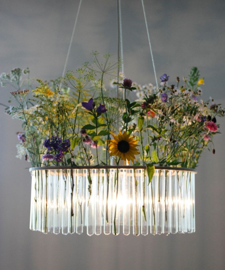 I have fallen in love with this test tube chandelier, perfect for displaying pretty country flowers x