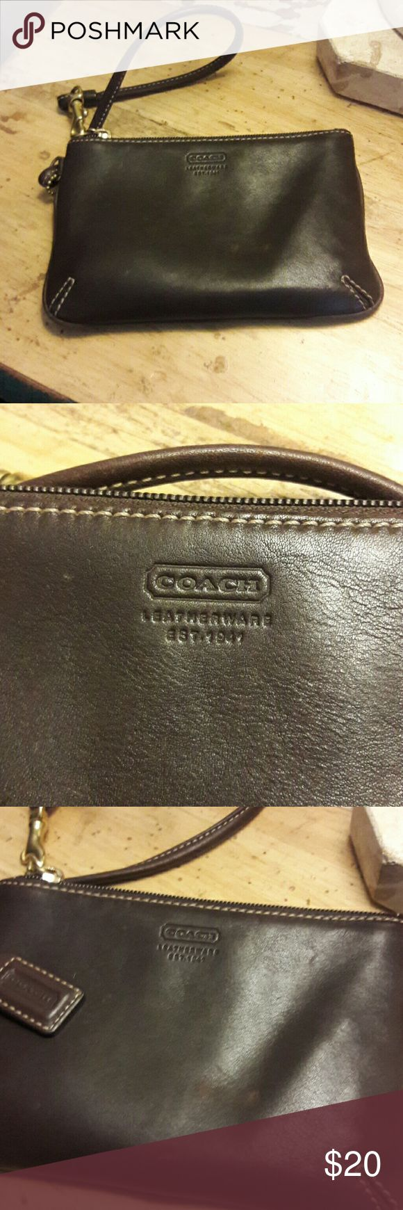 Coach chocolate brown wristlet new w/o tags Very luscious shade of brown wristlet.  Never used, but had small scruff mark on front even though new. Not too noticeable because of leather.  Have marked price down.  Please see picture 4. Coach Bags Clutches & Wristlets